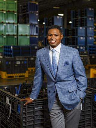 Condrad Daniels, president of HJI Supply Chain Solutions, poses for a portrait inside his east end facility.