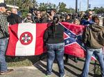 A Nazi, Klan member and confederate sympathizer face protestors at UNF