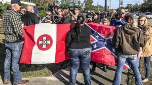 A Nazi, Klan member and confederate sympathizer face protestors at UNF