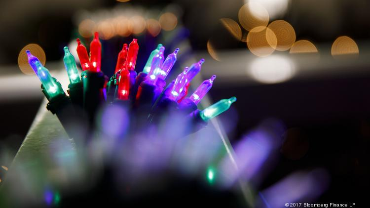 a string of mini christmas lights glow