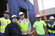 Watching ongoing work at Langtree are (from left) Samet Corp. construction executive Jeff Kennedy, project architect Randy Sides of JHS Architecture of Columbia, S.C., and project manager T.J. Baker. Greensboro-based Samet is building the first phase of apartments.