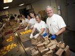 Better than happy hour: Volunteering together as a company