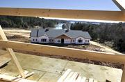 The Langtree clubhouse and Lake Norman as seen from top floor of one of the apartment buildings under construction.