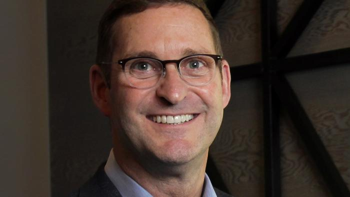 John Schoettler, Amazon's Vice Pres. of Global Real Estate and Facilities, is the PSBJ's 2017 Exec. of the Year is pictured at the Community Table by Farestart within Amazon's Hodini North building, 399 Fairview in Seattle, Dec. 8, 2017.