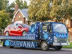 Carvana unveils (possibly) the world's largest ugly Christmas sweater on wheels