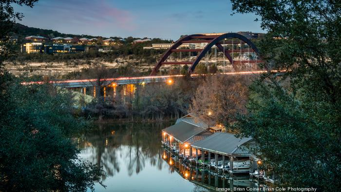 Dennis Quaid's home sits in the shadow of the Pennybacker Bridge and includes a single slip boat dock.
