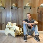 Tattoo artist expands studio, skull exhibit with midtown move
