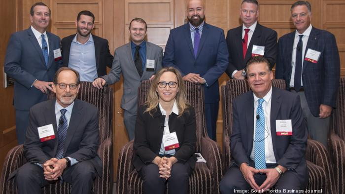 Front row L to R: Steve Messing, director real estate tax services for Berkowitz Pollack Brant Advisors and Accountants, Jackie Soffer, CEO and co-chairman of Turnberry Associates and Edward Mitchell, regional senior vice president for Duke Realty. Back R