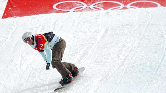 Swiss snowboarder Tanja Frieden races in the first ever Ladies' Snowboard-Cross Olympic event, winning a gold medal at the 2006 Winter Olympics in Bardonecchia, Italy, February 17, 2006.