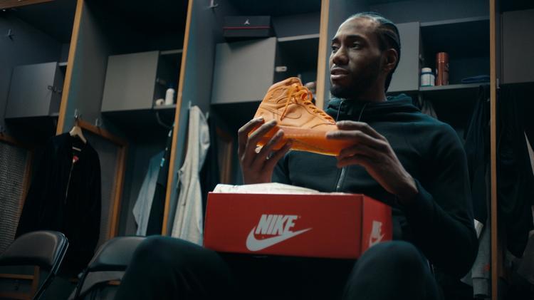2d6e389b4030 Kawhi Leonard opens a gift from San Antonio Spurs teammate LaMarcus  Aldridge in a new Nike