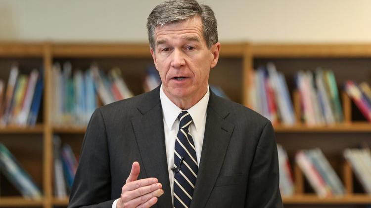 In signing his latest executive order, Gov. Roy Cooper touted clean energy as a way to reduce the impact of climate change and boost the North Carolina economy.