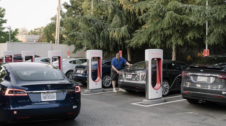 Electric Vehicle Tax Credit Survives But G M And Tesla Aren T Cheering