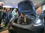 Elon Musk roundup: Tesla's Model 3 arrives in stores… SpaceX's Dragon capsule arrives home