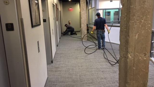 Jump Fiber LLC is installing internet equipment in the Rand Building downtown.