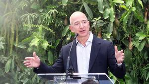 A spray of mist falls (upper left) behind Amazon founder and chairman Jeff Bezos as he speaks at Amazon's spheres much-anticipated grand opening in Seattle, Jan. 29, 2018.