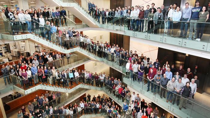 More than 300 of the scientific staff on-hand at the Allen Institute took a five minute break from their research to flood the catwalks and stairways of their headquarters in Seattle, Feb. 13, 2018 for this group photo commemorating the institute's recogn