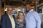 Dantanna's co-owner Jay Kazlow, Rally President Dean Crowe and Falcons player Corey Peters.