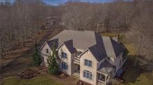 Indulge in luxury living! Exceptional craftsmanship & privacy abounds!