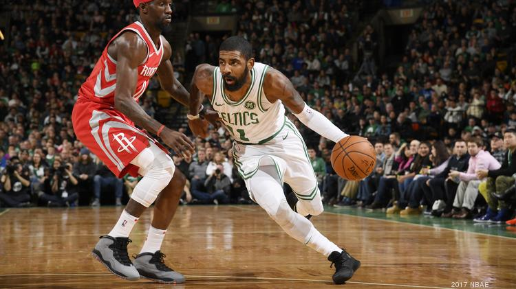 b174b065260 Kyrie Irving #11 of the Boston Celtics handles the ball against the Houston  Rockets on