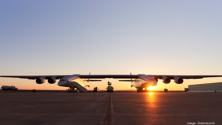 Paul Allen rolls his massive Stratolaunch spacecraft out from the