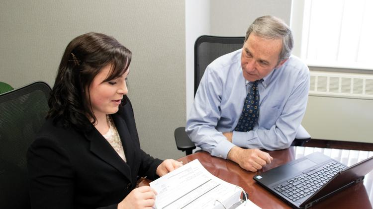 A team approach to cases works for nurse paralegal Mary Versterling and attorney Patrick Curran.