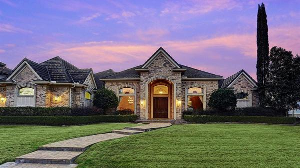 Enjoy Texas Sunsets and Golf Course Living At The Magnificient Royal Oaks Country Club Home