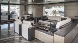 in the main salon looking aft. The large double glass door opens automatically to provide access to the aft deck.