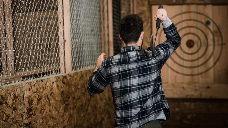 A Blade Timber Patron Tries His Hand At Ax Throwing