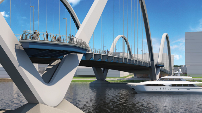 The future is dense on either side of the new Frederick Douglass Memorial Bridge span