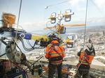 Space Needle crews lift 2,300-pound glass panels to observation deck (Photos)