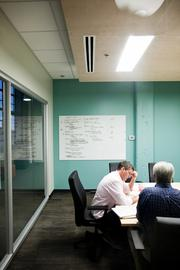 Creative Director Gregg Boling, left, consults with Jeff Lipscomb.