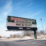 Group targets <strong>Koch</strong> with Wichita billboards pitching tax bill repeal