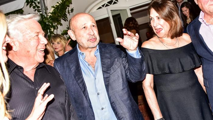 From left: Robert Kraft, Lloyd Blankfein and Laura Blankfein during the Apollo TheaterÕs summer benefit, at the home of Ronald Perelman in East Hampton, N.Y., Aug. 12, 2017. (Dolly Faibyshev/The New York Times)