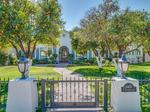 Home of the Day: Mature fruit trees, plush green grass and quaint fencing surrounding this charming home!