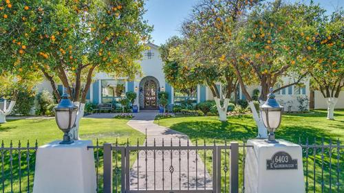 Mature fruit trees, plush green grass and quaint fencing surrounding this charming home!