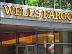 Wells Fargo fined $1B for abuses; will cut 1Q earnings by $800M