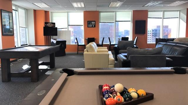 Milwaukee's Coolest Offices: New Resources' office features lounge with foosball and golf simulator