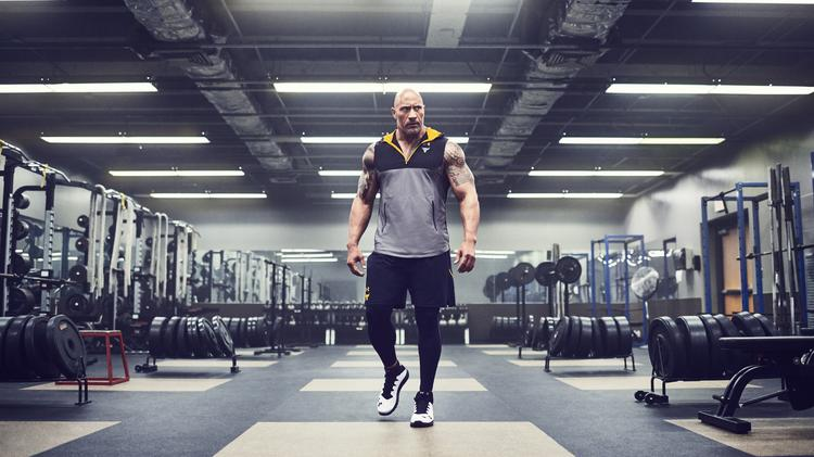 aae4f188c9 A new ad campaign promoting Under Armour's newest collection of training  gear features Dwayne