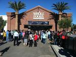 Whole Foods' profit is up but sales slow and 2014 outlook is cut slightly