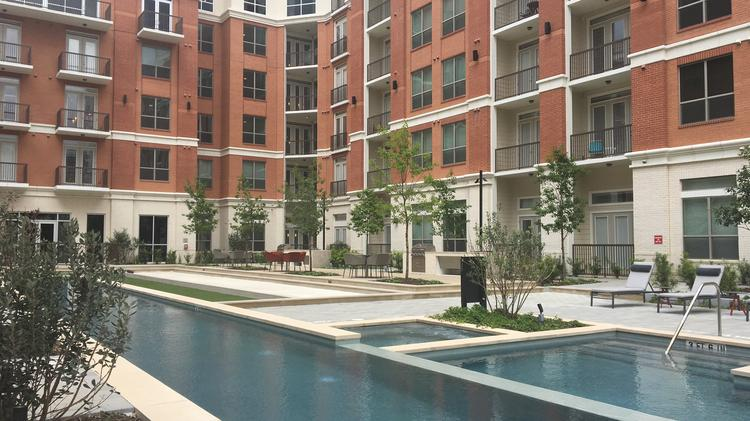 The Outdoor Pool And Lounge Area At Mark In Springwoods Village A New Report