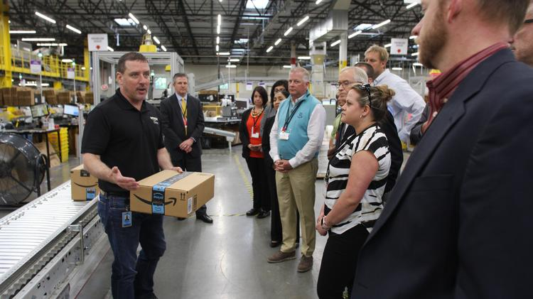 82b9dd1a Matt Smith, general manager of Amazon's Etna, Ohio facility, leads several  dozen business