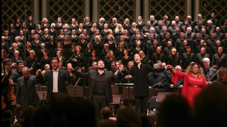Conductor Eun Sun Kim, soloists, chorus and orchestra take bows at the end of Verdi's Requiem to open the May Festival season in Music Hall.