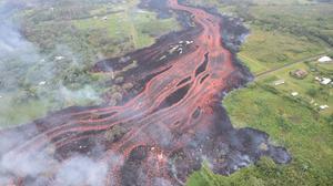 Explosive eruption at Kilauea volcano sends ash 7,000 feet high, lava flow enters ocean