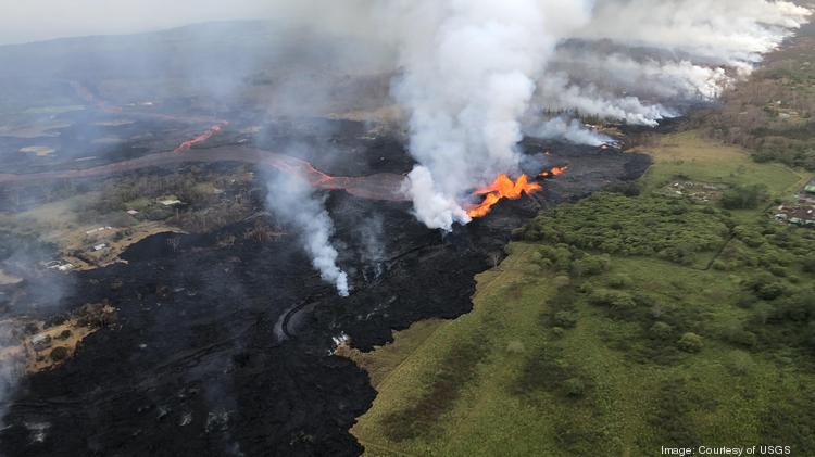 A small lava flow from fissure No. 22 has entered the Puna Geothermal Venture power plant, which is located in the east rift zone of the Kilauea volcano on Hawaii's Big Island. This file image shows an aerial view of erupting fissure 22 and lava channels flowing southward from the fissure during an early morning overflight on Monday, May 21, 2018.