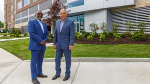 Carl Satterwhite, left, and Ed Rigaud, stand in front of the Offices @ Vernon Place. They were investors in both this project and the redevelopment of the Vernon Manor, which recently sold for more than $75 million.