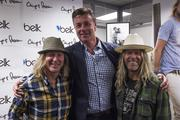 Brothers Chip Foster (left) and Pepper Foster (right), co-founders of clothing-design team Chip & Pepper, are pictured here with Belk executive John Thomas.