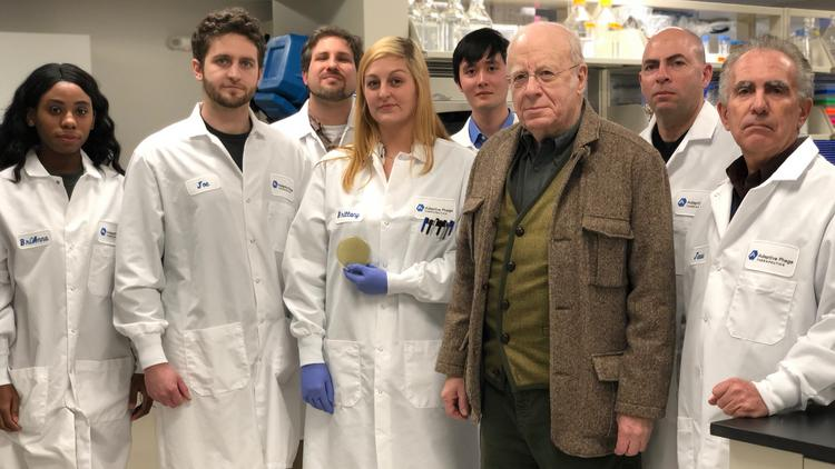 Dr. Carl Merril, third from right, with his son Greg, CEO and co-founder of Adaptive Phage Therapeutics, and other members of the team.