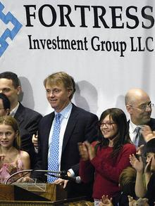 Wes Edens with Peter Briger and Randal Nardone of Fortress Investment Group