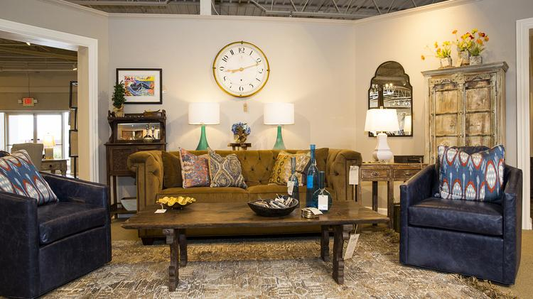 Attirant Blue Leather Chairs Flank An Antique Coffee Table In The New Merridian Home  Furnishings Showroom On