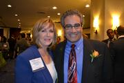 Karen Torres, from the Ronald McDonald House Charities, with honoree Rick Torres, president and CEO of the National Student Clearinghouse at the 2013 Minority Business Leader Awards.